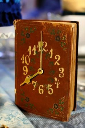 DIY Vintage Book Clock Table Number as seen on Hill City Bride Wedding Blog