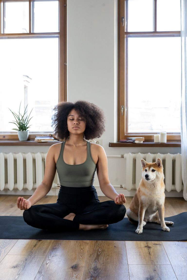 How to Avoid Wedding Stress Woman Meditating with Dog