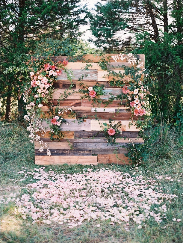 Living Coral Lynchburg Virginia Magical Woodland Wedding as seen on Hill City Bride by Adam Barnes Photography - flower pallet wall