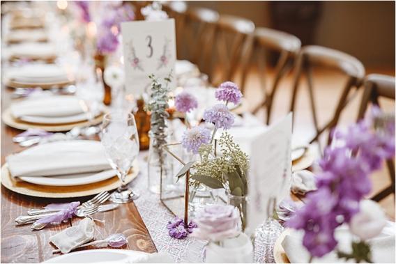 Vintage Heirloom DIY Wedding at the Aviary in Lynchburg Virginia Purple Lavender | Hill City Bride Wedding Blog Vintage Bottle Decor