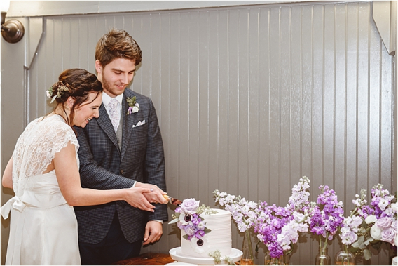 Vintage Heirloom DIY Wedding at the Aviary in Lynchburg Virginia Purple Lavender | Hill City Bride Wedding Blog Cake Cutting