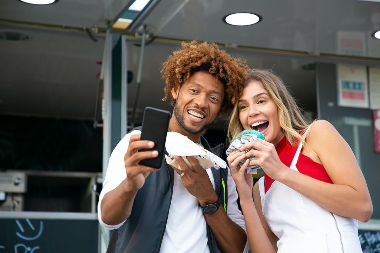 Mixed Couple Taking Selfie on Road Trip