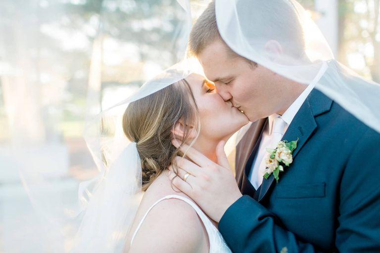 Bride Groom Kiss Under Veil