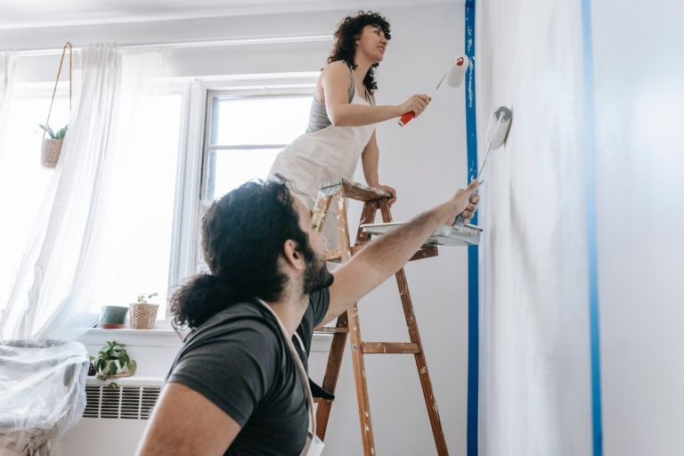 Couple Painting the Walls of a Room Together